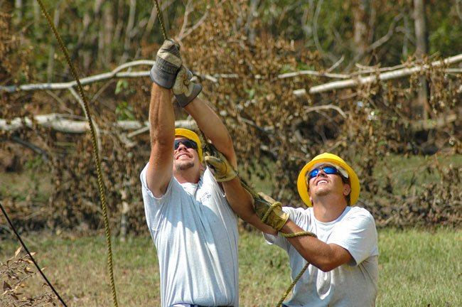 Crews restore power following Hurricane Katrina. Photo by Richard Biever